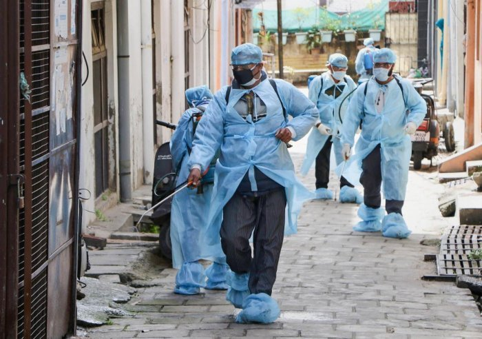 Health officials disinfect a street as part of measure to contain coronavirus pandemic, in Jammu, Saturday, March 14, 2020. (PTI Photo)