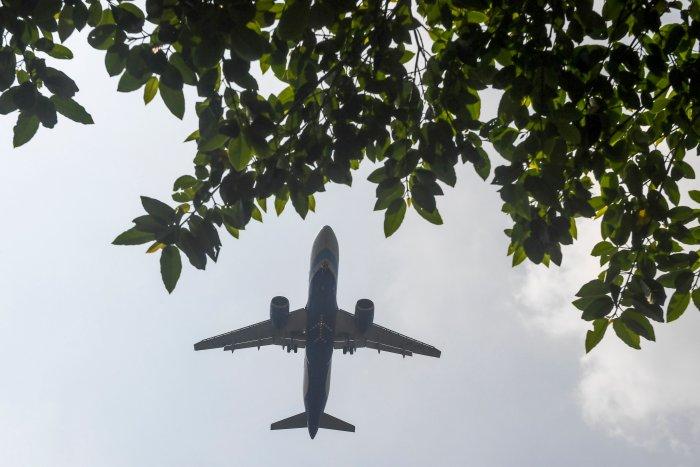 A commercial passenger plane prepares to land at Netaji Subhash Chandra Bose International Airport, in Kolkata. (Credit: AFP)