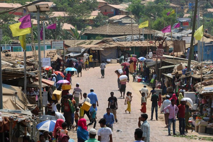 Rohingya refugees, without wearing any mask or any other safty gear as a preventive measure against the COVID-19 novel coronavirus, gather along a market area in Kutupalong refugee camp in Ukhia. (AFP Photo)