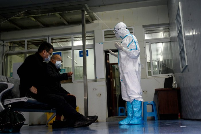 People wait to be screened at a fever clinic at Huanggang Zhongxin Hospital in Huanggang, in China's central Hubei province. (Credit: AFP)