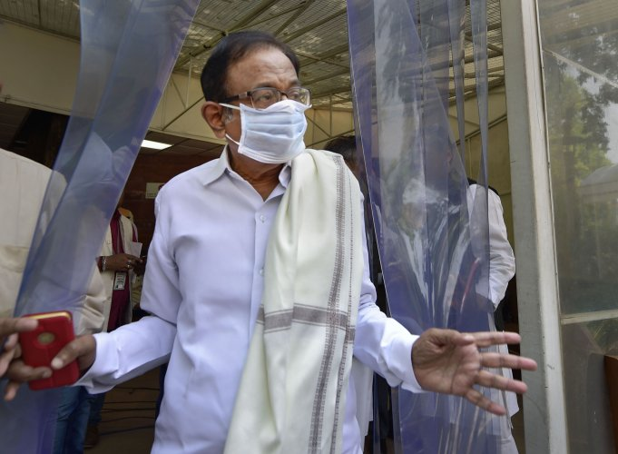 Senior Congress leader P Chidambaram wears a mask at Parliament, during the ongoing Budget Session. (Credit: PTI)