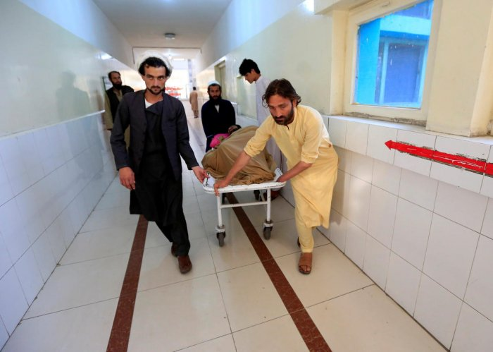 An injured man is transported on a stretcher in a hospital, after blasts at sports stadium, in Jalalabad city, Afghanistan May 19, 2018. (REUTERS/Parwiz)