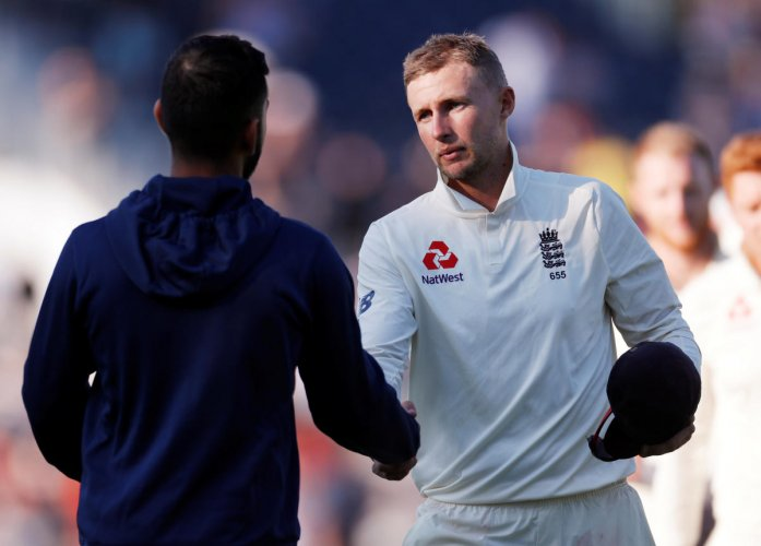 England's Joe Root shakes the hand of India's Virat Kohli after the match. Reuters Photo