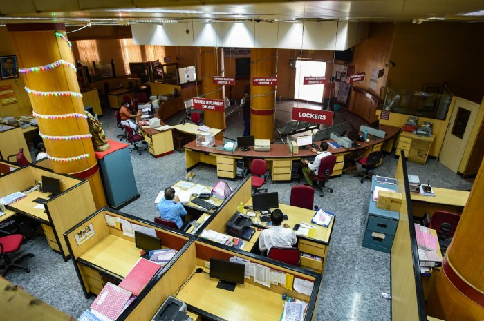 Banking staff continues to carry out operations with minimum staff after lockdown amid the coronavirus outbreak. (PTI Photo)