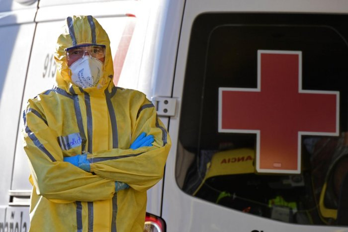 A Civil Defence member stands next to a Red Cross ambulance outside the Severo Ochoa hospital in Leganes, on March 26, 2020. Credit: AFP Photo