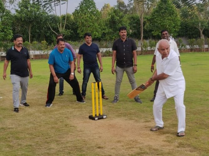 BJPs state unit media cell released a photo of Yeddyurappa playing cricket with party MLAs.
