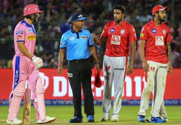 Rajasthan Royals' Jos Butler (left) reacts after being 'mankaded' by Kings XI Punjab's R Ashwin (second from right) during their IPL game on Monday. PTI
