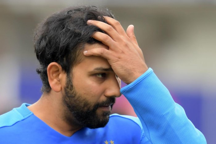 SHELL-SHOCKED Rohit Sharma looks extremely dejected after India lost in the semifinals to New Zealand on Wednesday. AFP