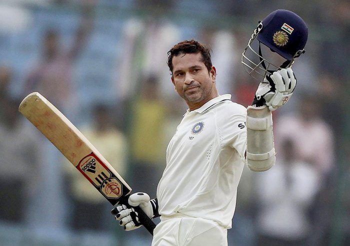 Sachin Tendulkar celebrates his 15,000 runs during the third day of the first cricket test match against West Indies, in New Delhi on Nov 8, 2011. (PTI Photo)