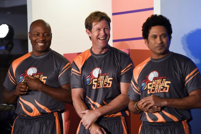 (From left) Former cricketers Brian Lara, Jonty Rhodes and Sachin Tendulkar share a light moment during a promotional event in Mumbai on Thursday. AFP