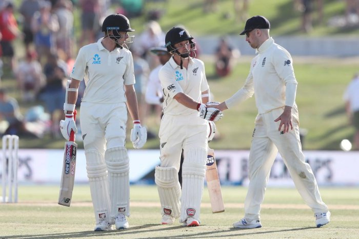 New Zealand's BJ Watling (C) shakes hands with England's Jack 1(R) at the end of play during the third day of the first Test cricket match between England and New Zealand at Bay Oval in Mount Maunganui New ZealandNew Zealand's BJ Watling (C) shakes hands with England's Jack Leach (R) at the end of play during the third day of the first Test cricket match between England and New Zealand at Bay Oval in Mount Maunganui New Zealand (AFP Photo)