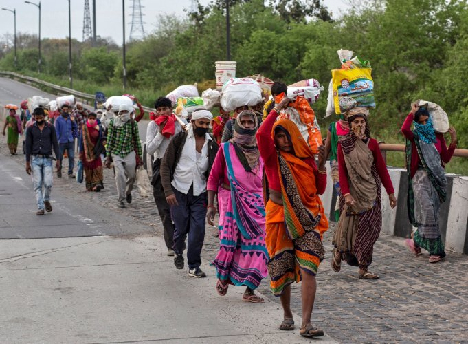 Friends and relatives of Kushwaha family who work as migrant workers walk along a road to return to their villages, during a 21-day nationwide lockdown to limit the spreading of coronavirus. (Reuters Photo)