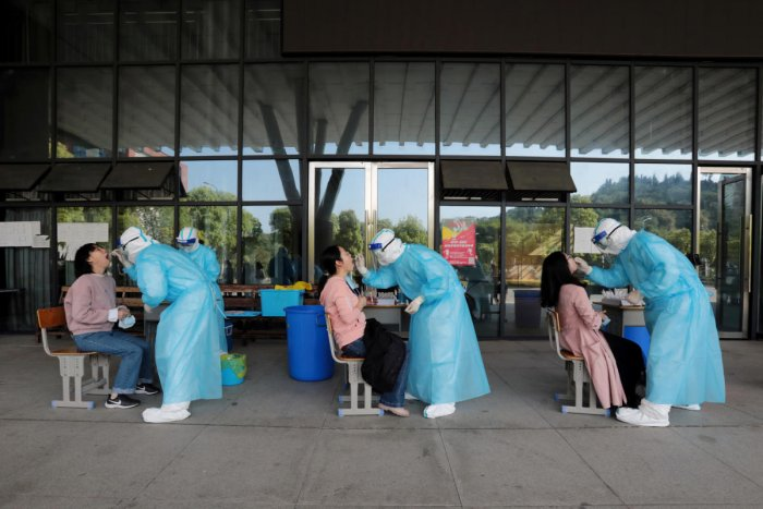 Medical workers from a hospital collect swabs from high school teachers for nucleic acid tests at a school, following the coronavirus disease (COVID-19) outbreak, in Yichang, Hubei province, China April 27, 2020. Credit: Reuters Photo