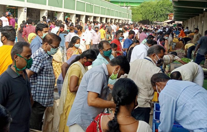 People flout lockdowm norms as they shop at a vegetable market, during the nationwide lockdown to curb the spread of coronavirus, in Coimbatore, Saturday, April 25, 2020. (PTI Photo)
