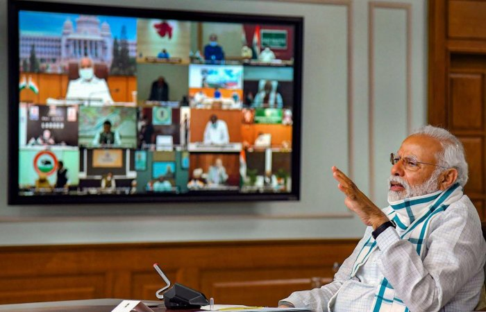 Prime Minister Narendra Modi (foreground) interacts with the Chief Ministers of various States/UTs via video conferencing to discuss the situation arising due to the novel coronavirus pandemic, in New Delhi, Monday, April 27, 2020. (PTI Photo)
