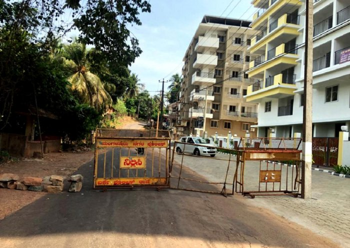 Police sealed the road after Dakshina Kannada Deputy Commissioner declared Kakkebettu in Shaktinagar in Mangaluru as an active containment zone, close on the heels of patients P-506 and P-507 testing positive for coronavirus on Monday.