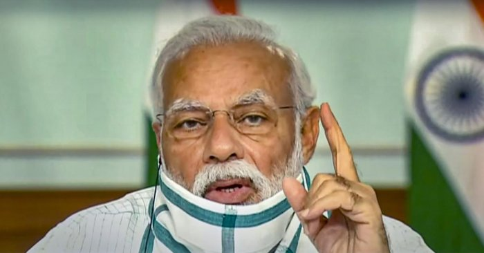 Prime Minister Narendra Modi wearing a protective mask interacts with the Chief Ministers of various States/UTs via video conferencing to discuss the situation arising due to the novel coronavirus pandemic, in New Delhi, Monday, April 27, 2020. (TV GRAB/PTI Photo)