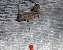 Helicopters dump water to cool Japan n-plant