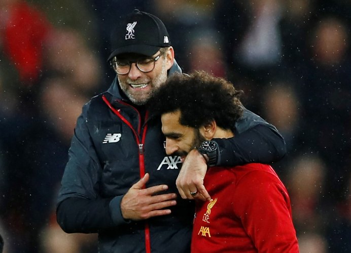 Liverpool's Mohamed Salah celebrates with manager Juergen Klopp after the match. (Reuters Photo)