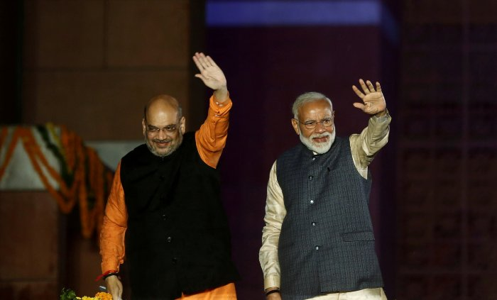 Indian Prime Minister Narendra Modi and Bharatiya Janata Party (BJP) President Amit Shah wave towards their supporters after the election results at party headquarter in New Delhi. (Reuters Photo)