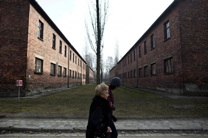 Jona Laks, survivor of Nazi Dr. Josef Mengele's experiments and her granddaughter, Lee Aldar walk as they visit the Auschwitz death camp, in Oswiecim, Poland. (Reuters Photo)