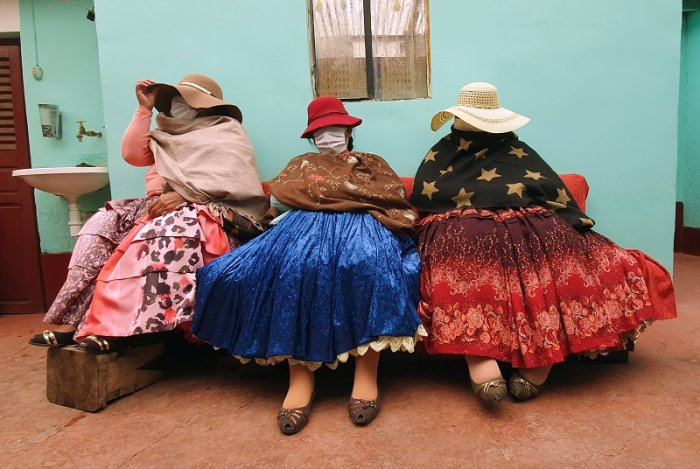 Bolivian sex workers sit during a Reuters interview before the countrywide, two-week mandatory quarantine to combat the spread of coronavirus disease (COVID-19), decreed by Bolivia's interim government, in El Alto outskirts of La Paz, Bolivia. (Reuters Photo)