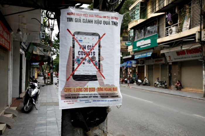 A poster warning against the spread of 'fake news' online on the coronavirus disease (COVID-19) is seen on a street in Hanoi. (Reuters Photo)