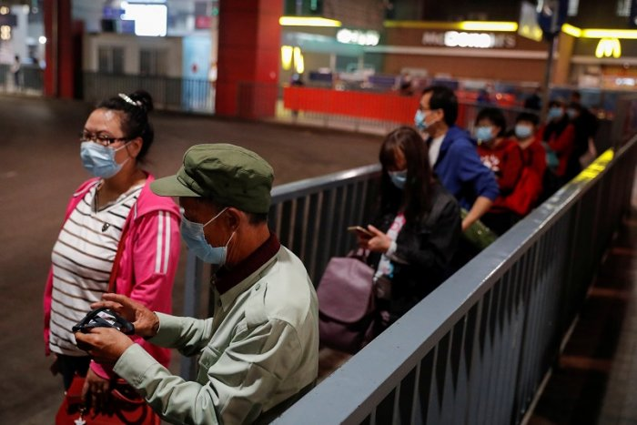 People wait for a bus at a regional bus station in Beijing as the spread of the coronavirus disease (COVID-19) continues in Beijing, China. (Reuters Photo)