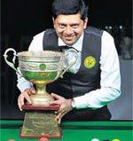 Manudev retains snooker crown