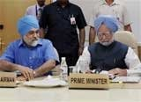 Effects of downturn melting; drought can be handled: Manmohan Singh