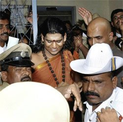 Nithyananda surrenders in court, arrested