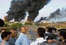 Oil depot fire dies down in 4 tankers, more bodies found