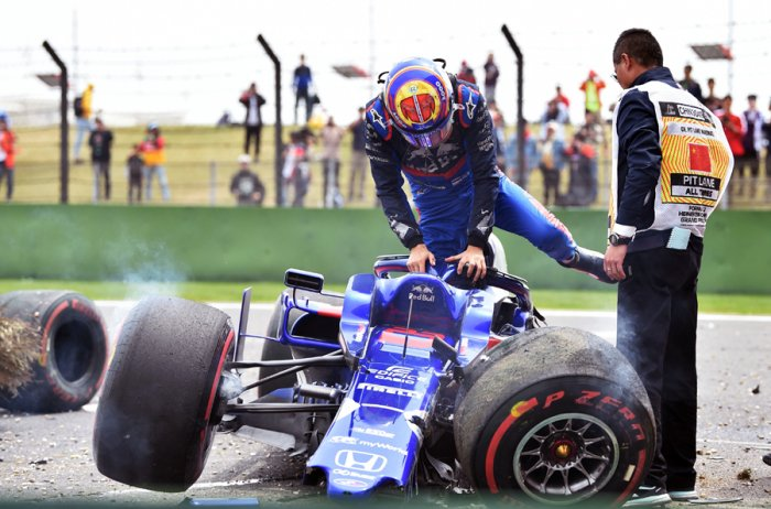 Alexander Albon climbs out of his crashed Toro Rosso car during final practice for the Chinese Grand Prix in Shanghai on Saturday. Picture credit: AFP