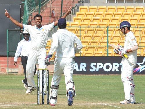 K'taka score historic win over Mumbai, enter knockout stage