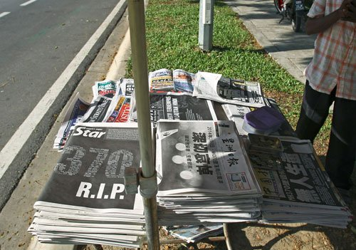 Malaysian papers turn black in tribute to crashed jet