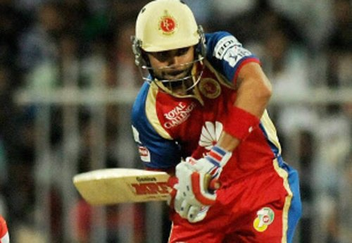Dominant RCB outplay MI by seven wickets