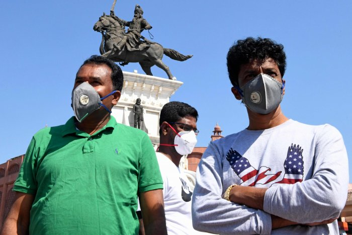 People wearing facemasks amid concerns over the spread of the COVID-19 novel coronavirus. (AFP Photo)