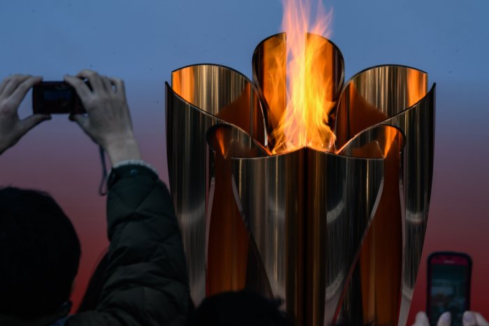 The Tokyo 2020 Olympic flame is displayed outside Sendai railway station, Miyagi prefecture on March 21, 2020, after arriving from Greece. (Credit: AFP)