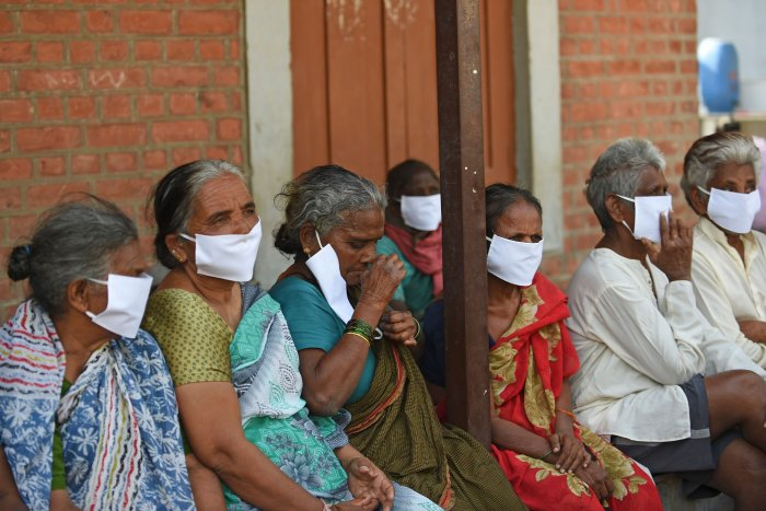 Leprosy affected people, wear facemasks being distributed by a non-governmental organisation amid concerns over the spread of the COVID-19 novel coronavirus. (AFP Photo)