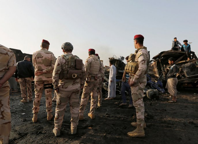 Suicide bombers kill 31 in Iraq's Tikrit: officers