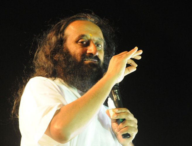 Hunt on for man over threat to Sri Sri