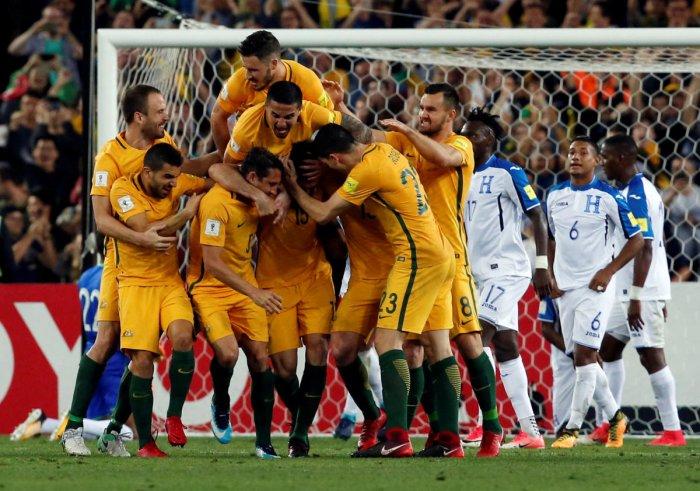 Jedinak hat trick sends Australia to World Cup