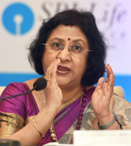 Don't wait to buy real estate, but buy and wait: former SBI chief
