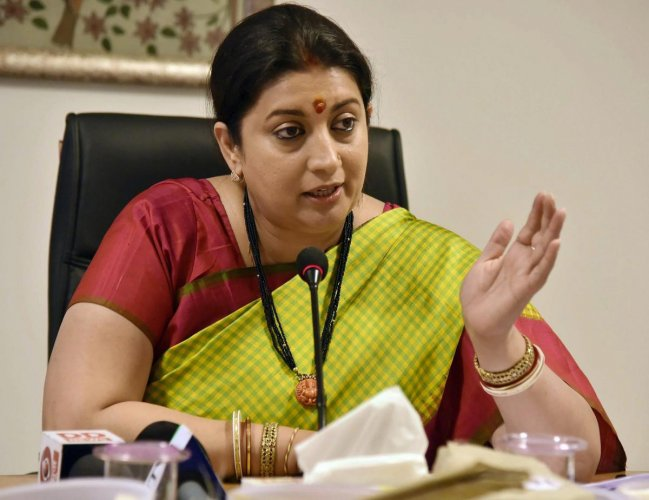 Irani questions Rahul on Sibal's dealings with businessman