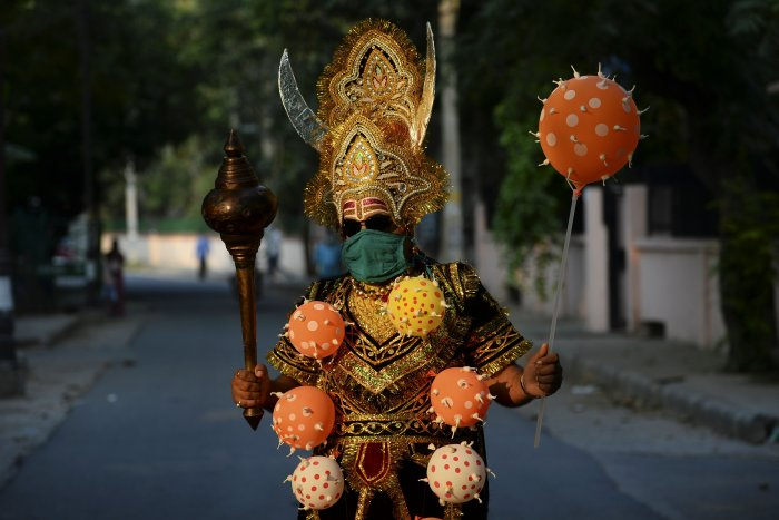 A man dressed as 'Yamraj', the Hindu mythical angel of death, campaigns to raise awareness on the importance to stay home and maintain social distancing during an event organised by Delhi police as India continues to remain under a nationwide lockdown. (AFP Photo)