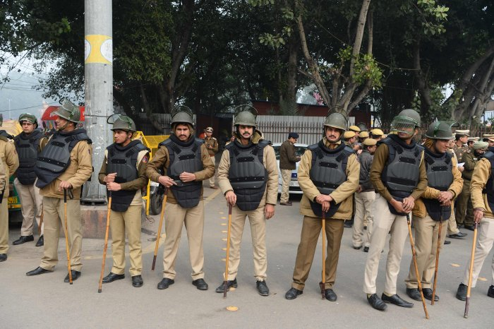 Police gather near the historic Red Fort at a demonstration against India's new citizenship law in New Delhi on December 19, 2019. - Big rallies are expected across India on December 19 as the tumultuous and angry reaction builds against a citizenship law seen as discriminatory against Muslims. (AFP Photo)