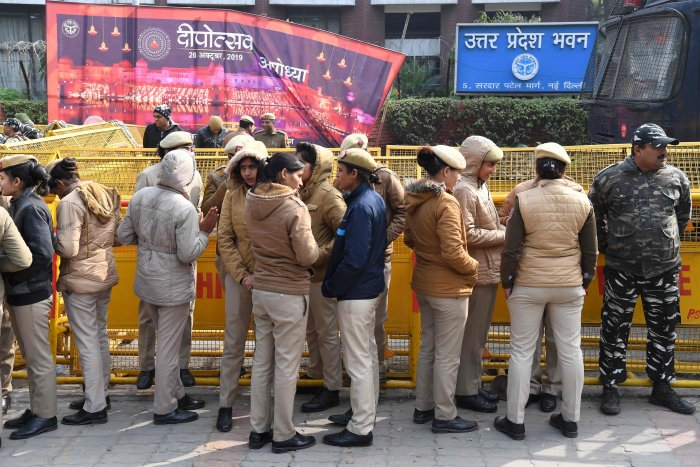 Delhi policewomen gather outside the Uttar Pradesh Bhawan (state house) before a demonstration against the crackdown on protesters in Uttar Pradesh state, over India's new citizenship law. (AFP Photo)