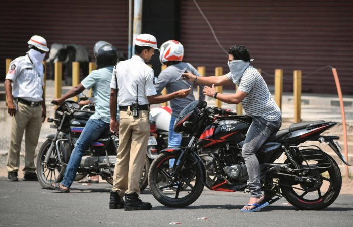 Police personnel stop commuters after lockdown in the wake of deadly coronavirus, in Vijayawada, Tuesday, March 24, 2020. (PTI Photo)