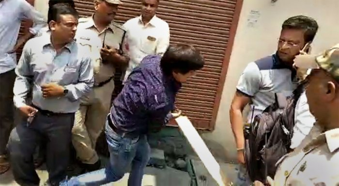 In this video still BJP MLA Akash Vijayvargiya is seen assaulting a civic official with a cricket bat in Indore on June 26, 2019. Vijayvargiya allegedly beat up the official for attempting to demolish a building of his supporter. PTI