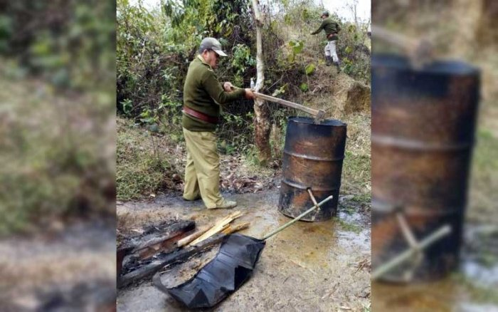 Officials of Assam's Excise Department and District Administration destroying units, making illicit liquors in Golaghat and other areas of the state. More than 15,000 litres of liquor has been destroyed till now. (PTI Photo)